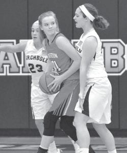 Kamryn Hostetler (23) and Faith Wyse, right, trap Wauseon's Chelsie Raabe on the baseline.– photo by Mario Gomez