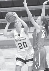 Pettisville's Nichole Foor shoots down low for a basket in the first quarter of Pettisville's non-league contest with Delta. Panther Jessie Giguere defends, right.– photo by Mary Huber