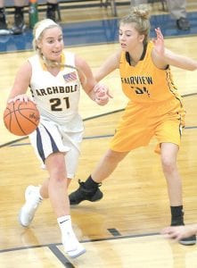 Emie Peterson (21) gets pressured defensively by Fairview's Riley Mealer. Peterson led the Streaks with 14 points.– photo by Mary Huber