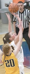 Lily Krieger scores on a putback.– photo by Mary Huber