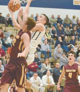Austin Wiemken gets fouled by Edgerton's Logan Showalter while driving to the basket, Thursday, Dec. 7 in their nonleague game. The junior led the Blue Streaks with 13 points against Holgate, Saturday, Dec. 16.– photo by Mario Gomez