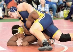 Mason Babcock works to turn his Toledo St. John's opponent at the Fricker's Duals. Babcock won a 10-3 decision.– photo by Mario Gomez