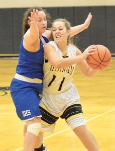 Stryker's Brittany Haines pressures Pettisville's Mikayla Graber (11) in their BBC showdown, Tuesday, Dec. 12.– photo by Mario Gomez