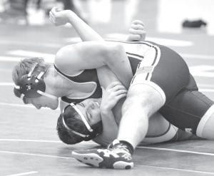 Gibson Burkholder (182 pounds) was one of four Blue Streak wrestlers who pinned their Delta opponents. He also won a 3-2 decision against his Bryan opponent.– photo by Mario Gomez