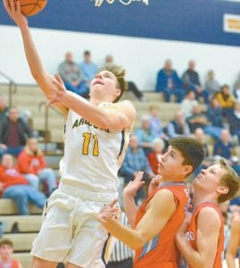 Elijah Zimmerman, left, drives to the basket while Caleb Wooley, right, uses a light touch down low for two points in