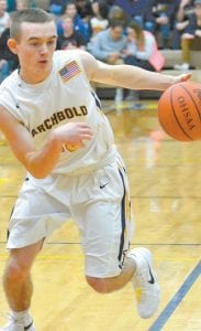 Hunter Beaverson brings the ball down the court.– photo by Mario Gomez