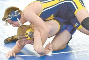 Colton Soles works to keep his man down on the mat. Soles went on to win the match and place fourth.– photo by Mario Gomez