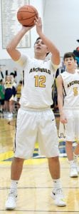 Travis Ziegler attempts a free throw in Archbold's contest with Fairview.– photo by Mario Gomez