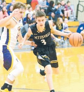 Pettisville's Logan Rufenacht (3) pushes the ball up the court against Fayette. He and Detric Yoder led the Birds with 12 points each in the 66-42 BBC victory.– photo by Mario Gomez
