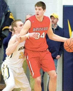 Austin Rotroff (34), who is 6 feet, 9 inches, towers over Archbold's 6-3 Caleb Wooley as the Blue Streak guards the Wauseon senior. Rotroff led a quartet of Indians who scored in double digits; he finished with 18 points.– photo by Mario Gomez