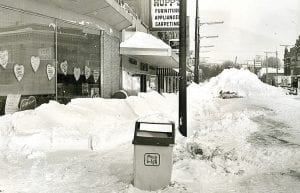 Left: Snow filled the main street of Archbold after the Blizzard of 1978. Right: Looking north from the railroad tracks after a partial cleanup.– Buckeye file photos