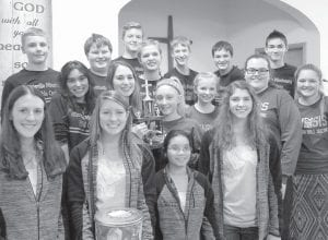 The smiles on these youngsters give testimony to the fun of quizzing in Northwest Ohio Bible Quiz. First row, from left: Aidan Borton, Bekah Liechty, Kendi Nofziger, Kelly Miller, West Clinton, who averaged 103 points in the meet Sunday, Jan. 28. Second row: Joselyn Estrada, Pettisville Missionary; Cara Aeschliman, Sophia DeGier, Grace Armstrong, Sierra Rupp and Violet Thomas, North Clinton, with the team traveling trophy for averaging 143 points. Back row: Joshua Norr, Samuel Ruffer, Isaac Norr, Natalie Roth, Weston Ruffer, Carson Bennett, and Hyatt Stamm, Pettisville Missionary, whose teams finished second and third, averaging 120 and 108 points.– courtesy photo