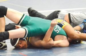 Andrew Francis tries to finish off his Sand Creek opponent during the Chuck Forward Duals, Saturday, Jan. 19.– photo by Mario Gomez