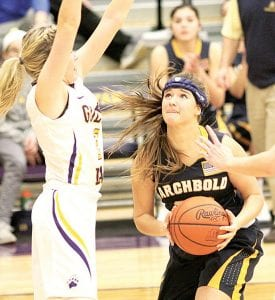 Archbold's Brooke Kohler, right, takes the ball to the basket with Bryan's Sidney Lamberson defending.– photo by Mary Huber