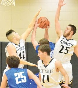 Pettisville's Graeme Jacoby (42) gets a hand in the way of the shot of Stryker's Kristian Grapengeter as Dillon King (25) helps from behind. Also on the play, Justin Rupp (11) keeps an eye out to prevent Luke Holsopple (25) from getting in on the play.– photo by Mario Gomez
