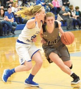 Morgan Leppelmeier (14) pushes back against the defensive pressure of Stryker's Emma Grime, Thursday, Feb. 1. The Panthers won the Buckeye Border Conference title with the win over the Birds.– photo by Mario Gomez