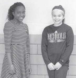 Chaina Nafziger, left, an Archbold sixth grader, has been named one of two top youth volunteers in Ohio through the Spirit of Community Awards. She lived in a Haitian orphanage before being adopted by a local couple, and held a bake sale to raise money for orphans in Haiti. Katie Stoner, right, a classmate, helped Nafziger with the project.– courtesy photo
