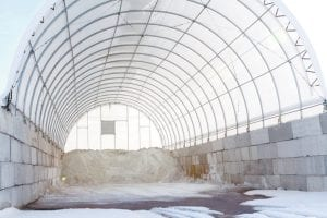 In spite of appearing nearly empty, Jason Martz, Archbold superintendent of streets, said he's confident the village has enough ice-melting road salt to last the remainder of the winter. This salt storage structure, approved by village council in the fall of 2014, can hold up to 1,000 tons of salt. The fabric-covered storage structure cost around $22,000. The village also has a second, older salt storage building. Martz said the village still has about 350 tons of salt on hand.– photo by Mary Huber