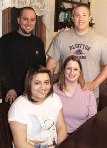 Jennifer Sauder-Nichols and her husband, David Nichols, hosted Jennifer's cousin, Jeremy Bonilla, and his girlfriend, Mara Collazo, who live in Puerto Rico. The group talked about Hurricane Maria, which struck the island in September 2017, and its aftermath. Seated, from left: Collazo and Sauder-Nichols. Standing are Bonilla and Nichols.– photo by David Pugh